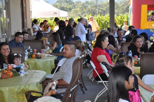Parents and kids having fun at annual harvest part
